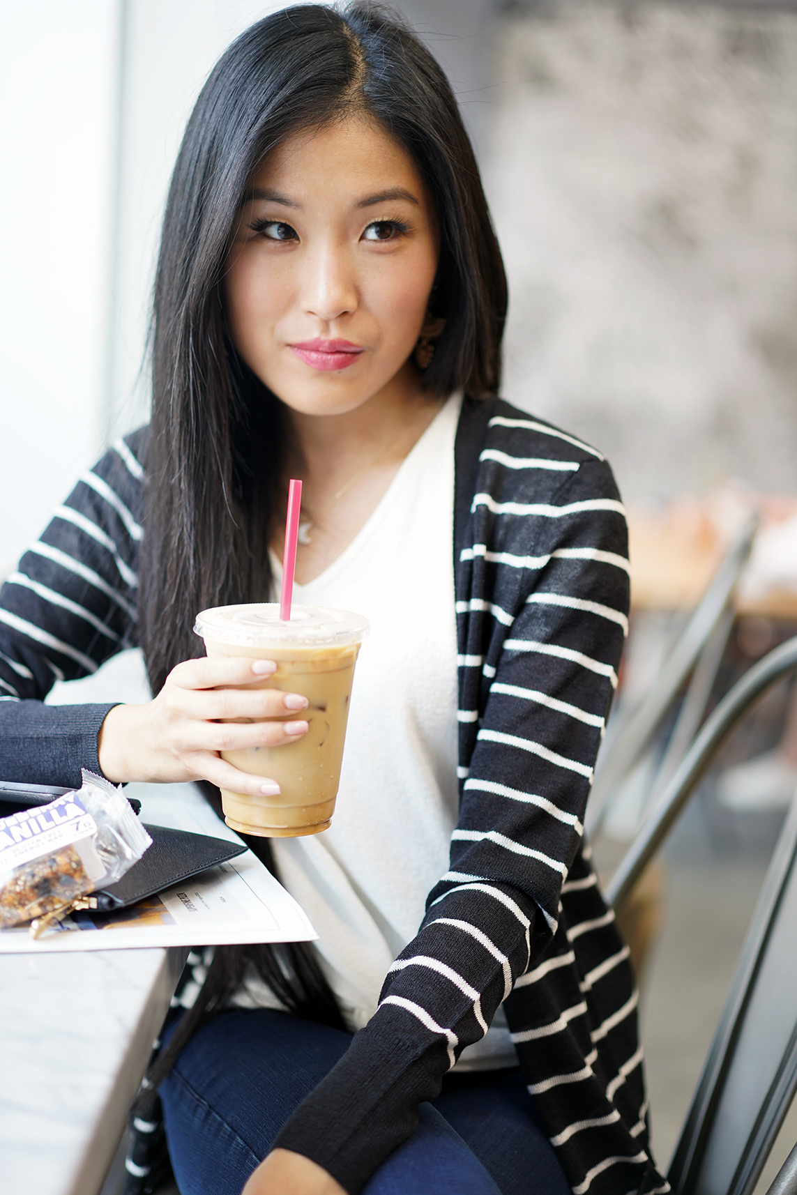 Halogen Long Linen Blend Cardigan with Black and Ivory Stripe Pattern and Giselle Fanned Linear Earrings from Francesaca's enjoying iced coffee from Cognoscenti Coffee