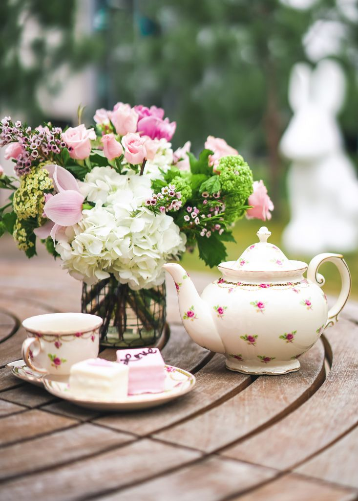 Millennial Tea Party with rose teacup and teapot and pink flowers