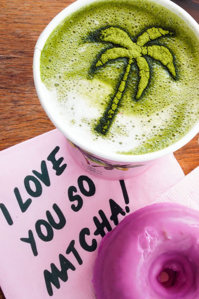 Cha Cha Matcha, Green Matcha Latte with Palm Tree Matcha Art, I love you so matcha pink napkin and pink vegan donut