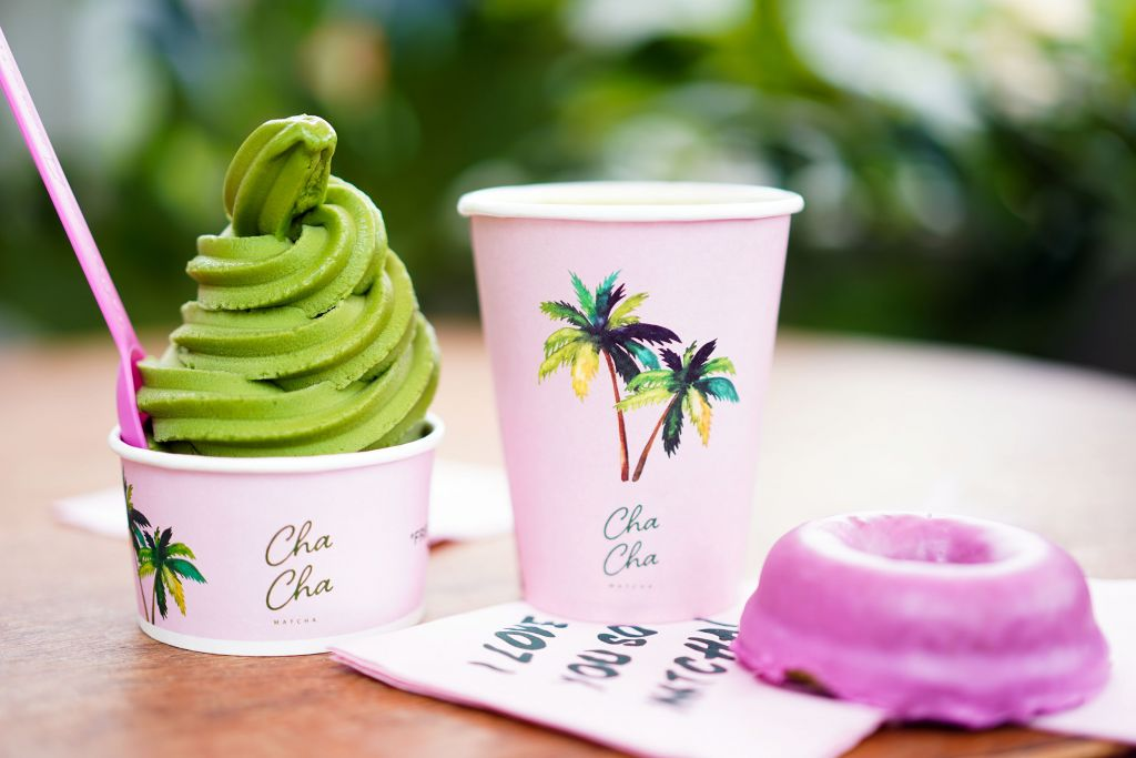 Cha Cha Matcha Vegan Matcha Soft Serve, Matcha Latte in Palm Tree Cup and Vegan Pink Donut
