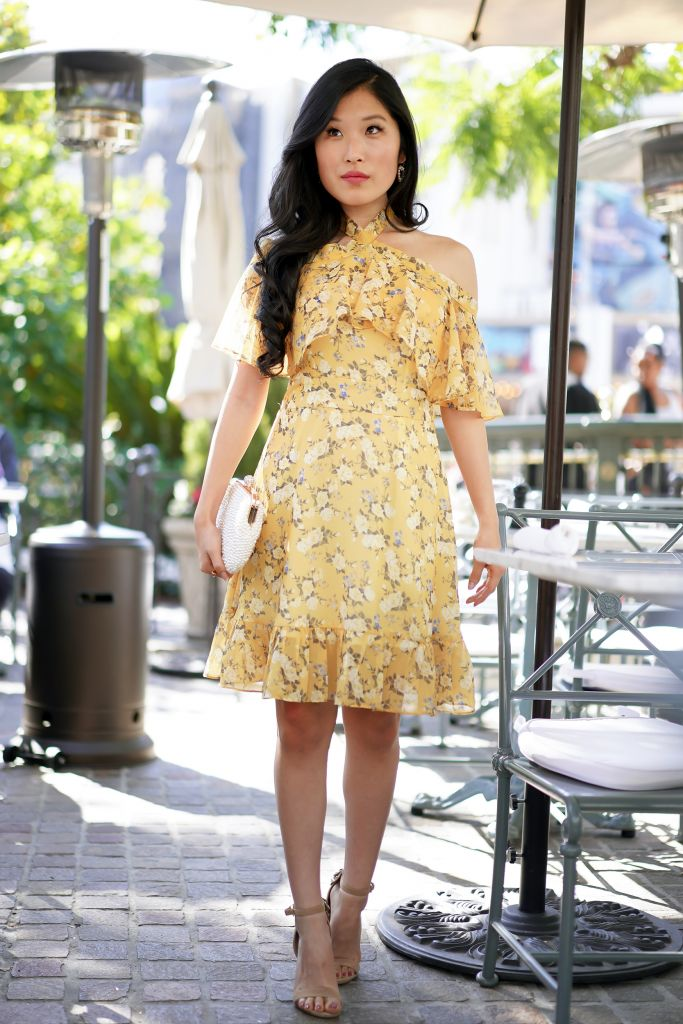 Chicwish Yellow Peony Print Halter Neck Ruffle Dress with peony flowers and faux pearl clutch
