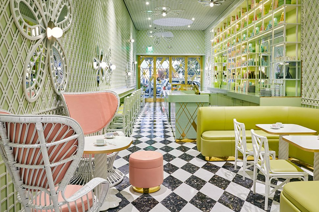 Laduree Beverly Hills Interior Seating with a black and white check floor and pink chairs