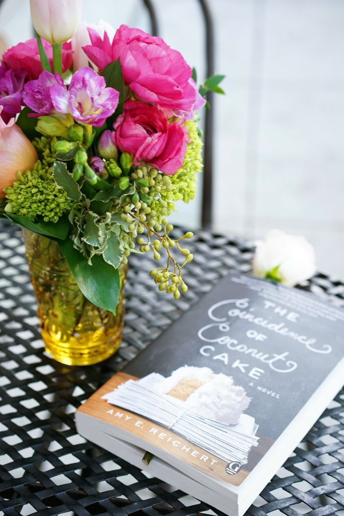 The Coincidence of Coconut Cake Book by Amy E. Reichert with a rose bookmark