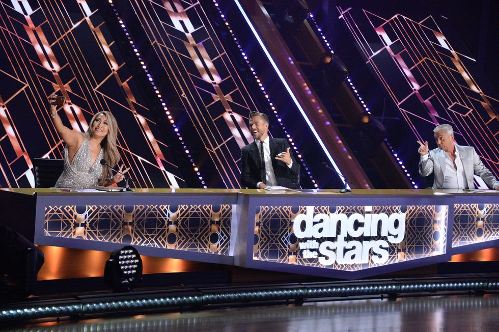 Dancing With The Stars Season 29 Judges - Carrie Ann Inaba, Derek Hough, Bruno Tonioli siting at the new judging table