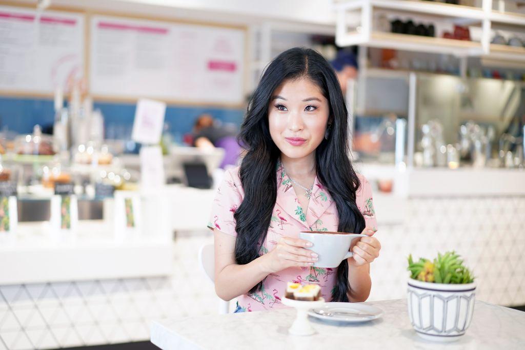 Parakeet Cafe, Inside Little Italy Location, Courtney Elise Kato enjoying a latte
