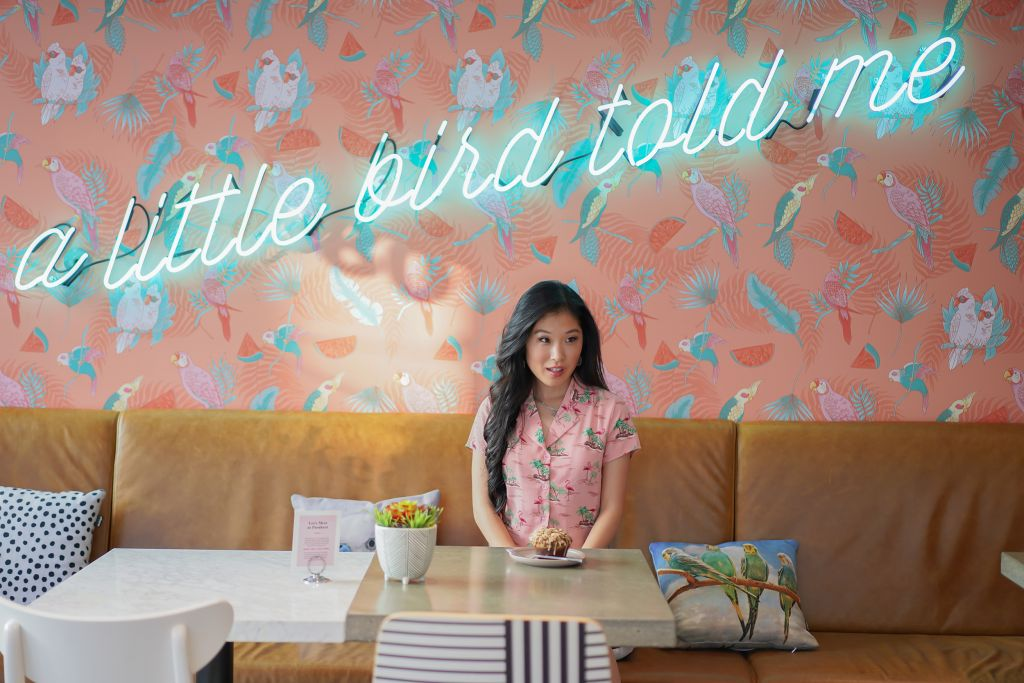 """Parakeet Cafe """"A Little Bird Told Me"""" neon blue sign inside Little Italy Location"""