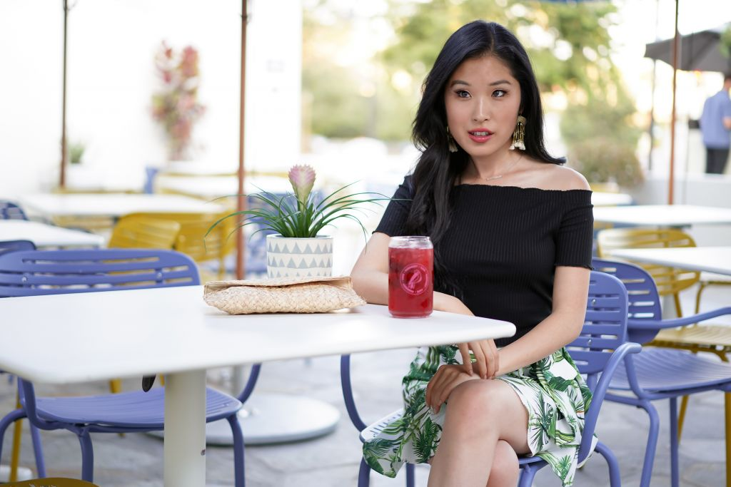 Courtney Kato enjoying a Herbal Hibiscus Ice Tea outside at the Parakeet Cafe outside patio at the Del Mar location in One Paseo