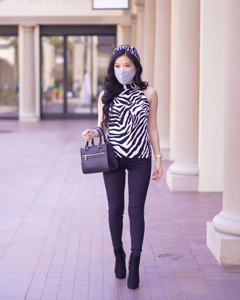 White House Black Market Petite Mock Neck Zebra Top paired with a NamJosh Beaded Zebra Headband and mask by Lele Sadoughi